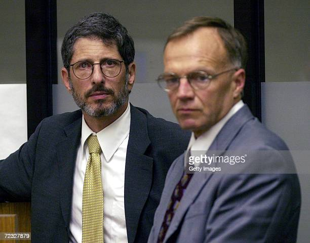 Lead defense attorney Steven Feldman and cocounsel Robert E Boyce listen to arguments from prosecutors during the arraignment of their client David...