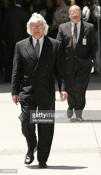 Lead defense attorney Thomas Mesereau walks in front of the courthouse as he waits for Michael Jackson to arrive for the verdict in Jackson's child...