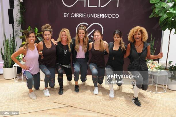 CALIA lead designer Carrie Underwood's road trainer Eve Overland helps attendees warm up before their workout celebrate the line's Fall/Winter 17...