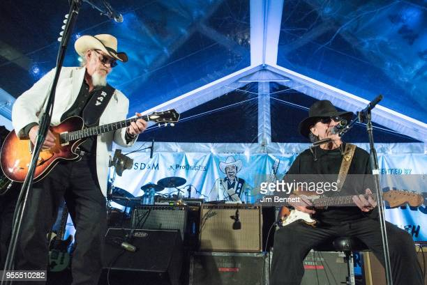 Lead guitarist and vocalist Ray Benson and singersongwriter and guitarist Tony Joe White perform live on stage at Ray's 67th birthday party concert...