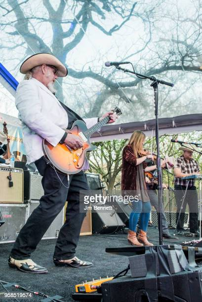 Lead guitarist and vocalist Ray Benson fiddle player and vocalist Katie Shore and pedal steel guitarist and saxophonist Eddie Rivers of Asleep At The...