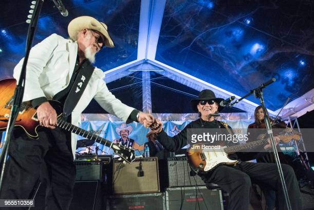 Lead guitarist and vocalist Ray Benson of Asleep At The Wheel and singersongwriter and guitarist Tony Joe White perform live on stage at Ray's 67th...
