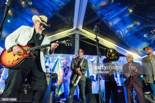 Lead guitarist and vocalist Ray Benson of Asleep At The Wheel and saxophonist Clint Maedgen tuba player Ben Jaffe clarinetist Charlie Gabriel and...