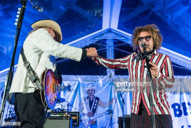 Lead guitarist and vocalist Ray Benson of Asleep At The Wheel fist bumps tuba player Ben Jaffe of Preservation Hall Jazz Band live on stage at Ray's...