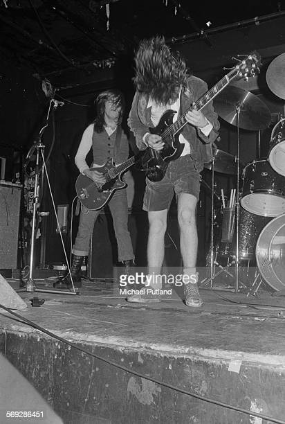 Lead guitarist Angus Young and rhythm guitarist Malcolm Young performing with hard rock group AC/DC at the Marquee Club London 12th May 1976