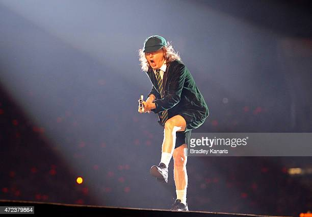 Lead guitarist Angus Young does his famous duck walk as AC/DC perform live for fans at Queensland Sport and Athletics Centre on February 25 2010 in...