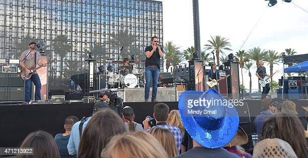 Lead guitarist James Young drummer Chris Thompson lead vocalist Mike Eli and bass guitar player Jon Jones of the Eli Young Band perform during...