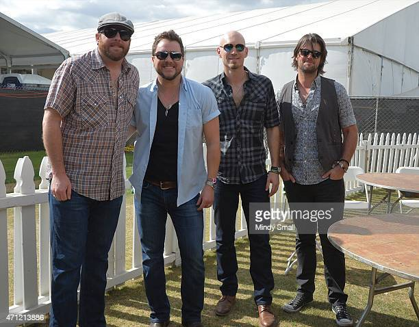 Lead guitarist James Young lead vocalist Mike Eli bass guitar player Jon Jones and drummer Chris Thompson of the Eli Young Band perform during...
