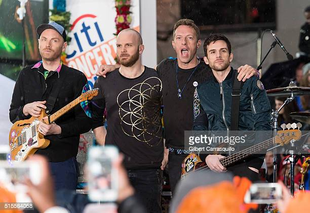 Lead guitarist Jonny Buckland drummer/backing vocalist Will Champion singer songwriter lead vocalist Chris Martin and bassist Guy Berryman of the...