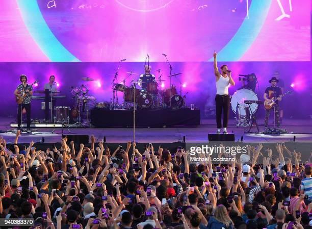 Lead guitarist Wayne Sermon drummer Daniel Platzman singer Dan Reynolds and keyboard/bassist Ben McKee of Imagine Dragons perform onstage during...