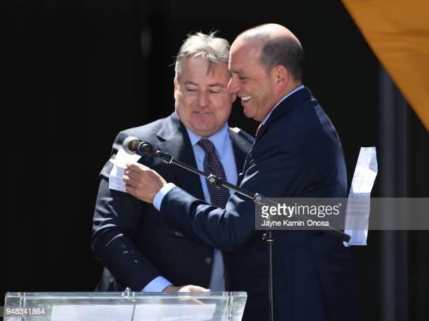 Lead managing owner of the Los Angeles FC Larry Berg is greeted by the Commissioner of Major League Soccer Don Garber as they trade positions at the...