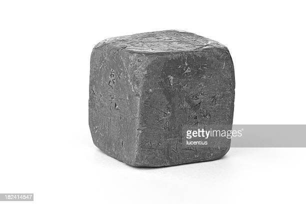 Lead metal cube isolated on white