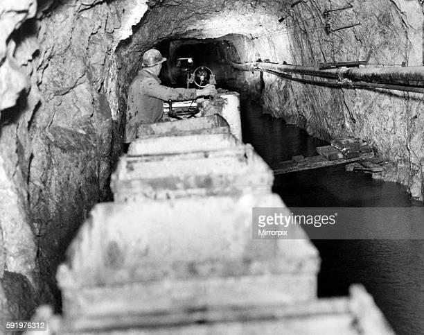 Lead Mine Rhydymwyn near Mold Flintshire Wales 5th March 1938 Battery powered locomotive train operating under flood conditions