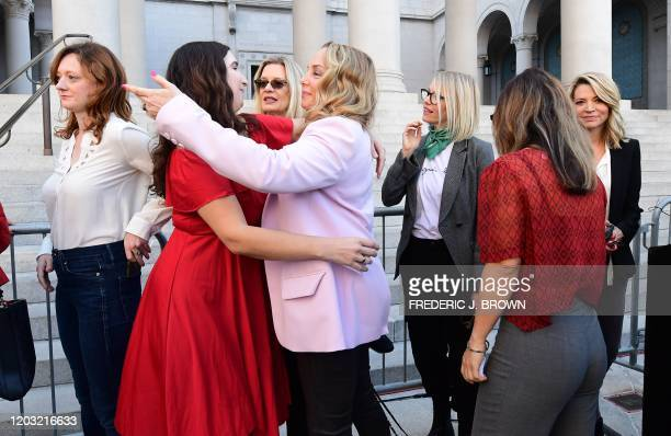 Lead plaintiff in the class action suit Louisette Geiss embraces Sarah Ann Masse as a group of Hollywood actresses and others, part of a group of...