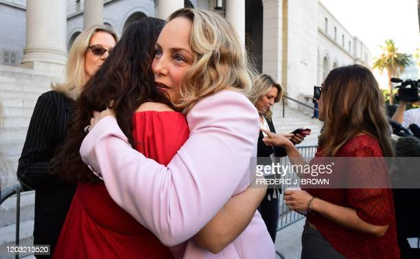 Lead plaintiff Louisette Geiss embraces Sarah Ann Masse as a group of Hollywood actresses and others part of a group of Silence Breakers who have...