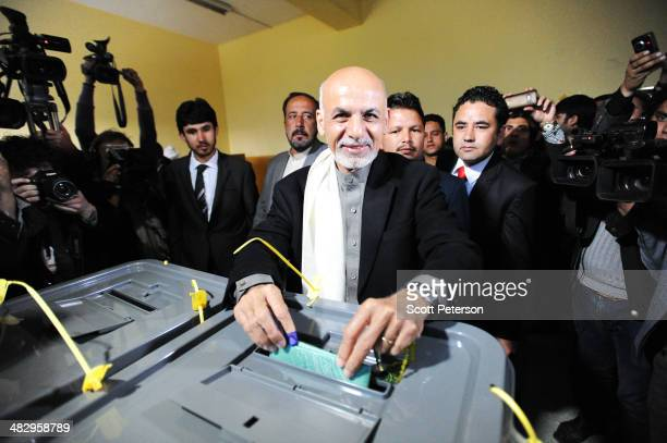 Lead presidential candidate Ashraf Ghani Ahmadzai casts his ballot as Afghans defy Taliban threats and vote in record numbers in elections on April 5...