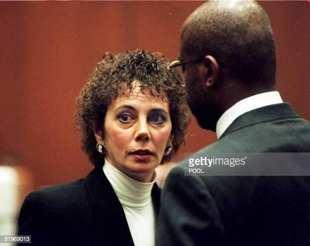 Lead prosecutor Marcia Clark talks with fellow prosecutor Christopher Darden during court proceedings 26 January 1995 in Los Angeles The OJ Simpson...