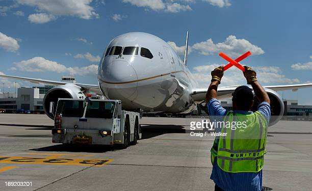 Lead ramp serviceman Michael Paolilo guides a Boeing 787 Dreamliner departing for Houston at Denver International Airport in Denver CO May 21 2013 It...