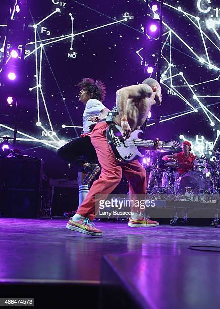 Lead singer Anthony Kiedis bassist Michael Flea Balzary and drummer Chad Smith of Red Hot Chili Peppers perform onstage at WFANs Big Hello To...