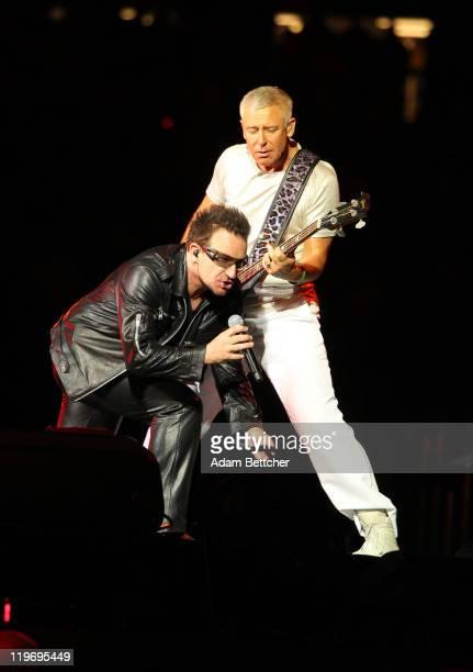 Lead singer Bono and bassist Adam Clayton of U2 perform at TCF Bank Stadium on July 23 2011 in Minneapolis Minnesota