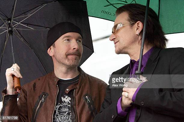 U2 lead singer Bono and The Edge wait for their turn to perform during the official opening ceremony of the Clinton Presidential Library November 18...