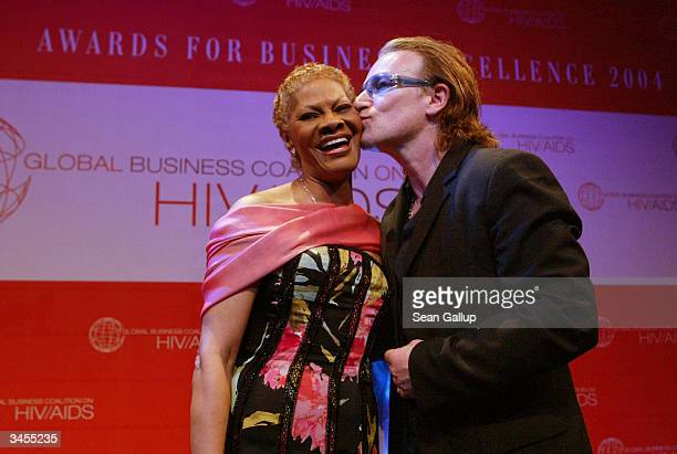 U2 lead singer Bono kisses singer Dionne Warwick at the Global Business Coalition on HIV/AIDS Awards and Dinner at the DaimlerChrysler Atrium on...
