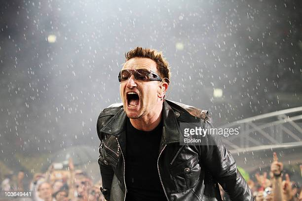 Lead singer Bono of Irish rock band U2 performs in the rain during their 360 Degree Tour at the Luzhniki stadium on August 25 2010 in Moscow Russia