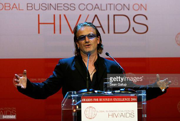 U2 lead singer Bono speaks at the Global Business Coalition on HIV/AIDS Awards and Dinner at the DaimlerChrysler Atrium on April 21 2004 in Berlin...