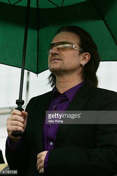 U2 lead singer Bono waits to perform during the official opening ceremony of the William J Clinton Presidential Center November 18 2004 in Little...