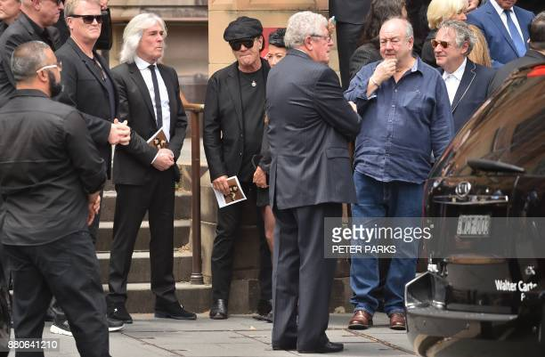 AC/DC lead singer Brian Johnson and bassist Cliff Williams gather after the funeral service for AC/DC cofounder Malcolm Young outside St Mary's...