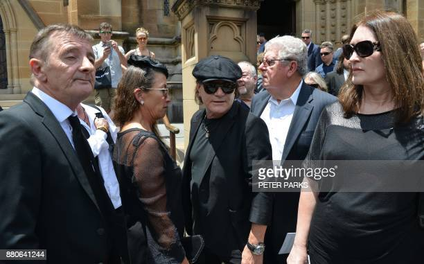 AC/DC lead singer Brian Johnson and drummer Phil Rudd gather after the funeral service for AC/DC cofounder Malcolm Young outside St Mary's Cathedral...