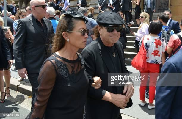 AC/DC lead singer Brian Johnson and his wife Brenda leave St Mary's Cathedral after the funeral service for AC/DC cofounder Malcolm Young in Sydney...