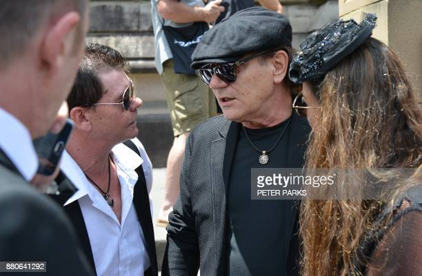 AC/DC lead singer Brian Johnson speaks with attendees after the funeral service of AC/DC cofounder Malcolm Young outside St Mary's Cathedral in...