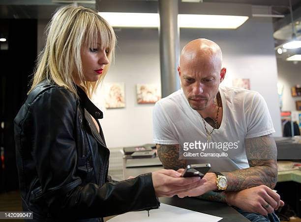 Lead singer Camilla Romestrand of the UK rock band Eddie The Gun discusses a tattoo design with tattoo artist Ami James to promote the release of the...