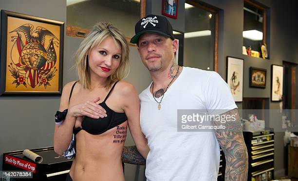 Lead singer Camilla Romestrand of the UK rock band Eddie The Gun poses with tattoo artist Ami James to promote the release of the new digital album...