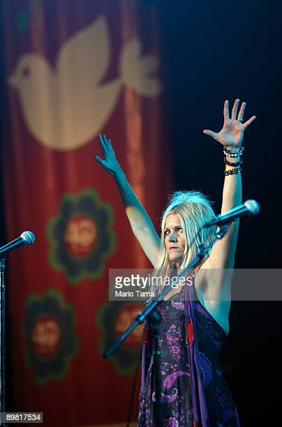 Lead singer Cathy Richardson of Jefferson Starship performs at the concert marking the 40th anniversary of the Woodstock music festival August 15...