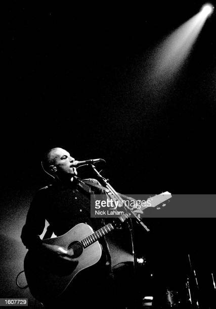 Lead singer Chris Martin of Coldplay performs with his band August 7 2001 during a concert at Enmore Theatre in Sydney Australia