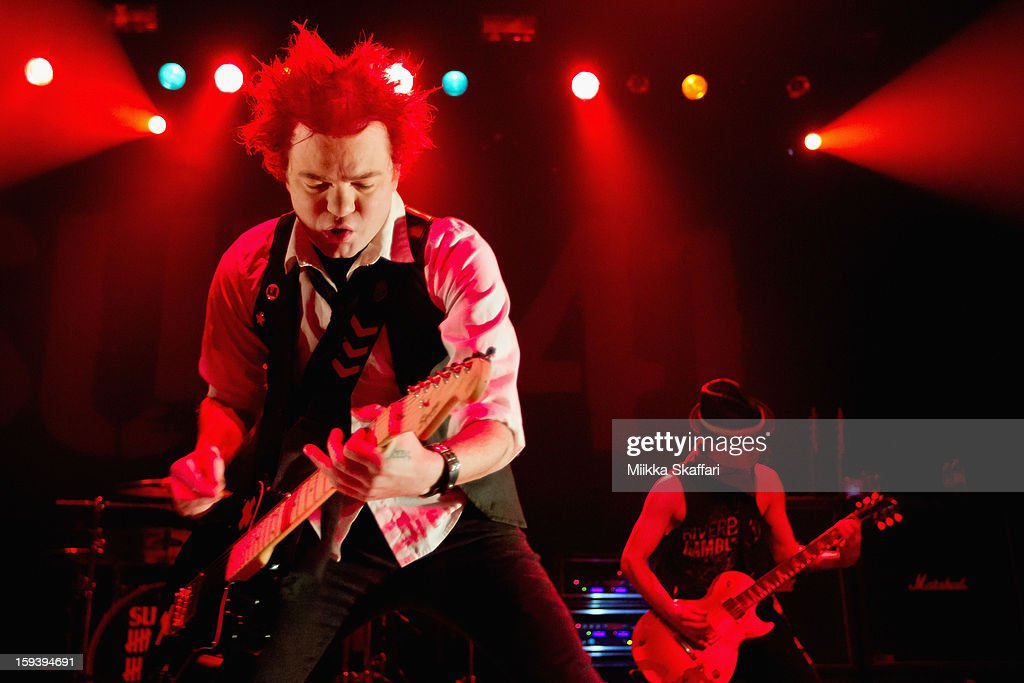 Lead singer Deryck Whibley and guitarist Tom Thacker of Sum 41 performs on stage at Grand Regency Ballroom on January 12, 2013 in San Francisco, California.
