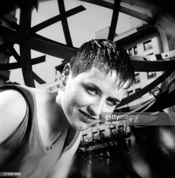 Lead singer Dolores O'Riordan of the Irish rock band The Cranberries poses for a portrait in front of a city sculpture circa June, 1995 in New York...