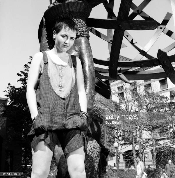 Lead singer Dolores O'Riordan of the Irish rock band The Cranberries poses for a portrait in front of a city sculpture circa June 1995 in New York...