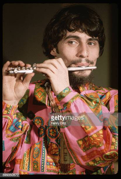 Lead singer Eddie Brigati of The Rascals plays the piccolo at a studio in Hollywood
