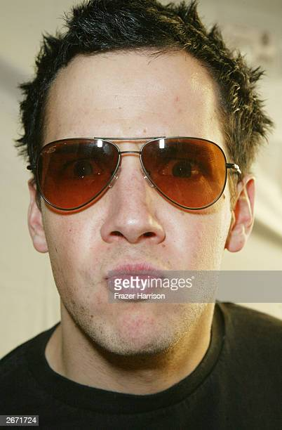Lead singer for Simple Plan Pierre Bouvier poses with a pair of Serengeti sunglasses at the 2003 Tall Pony Radio Music Awards gift lounge outside the...