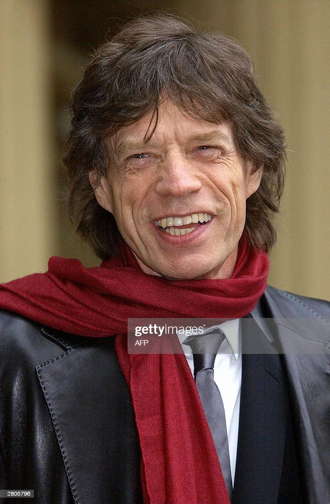 Lead singer for the Rolling Stones, Mick Jagger, smiles