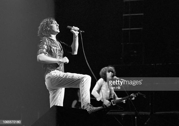 Lead singer Joe Elliott and songwriter-guitarist Pete Willis of Def Leppard perform at The Fabulous Fox Theater on September 4, 1981 in Atlanta,...