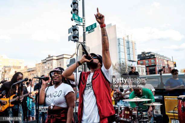 Lead singer Kenny of the Mental Attraction 2.0 Go-Go band performs at a rally on U Street on April 8, 2019 in Washington, DC.