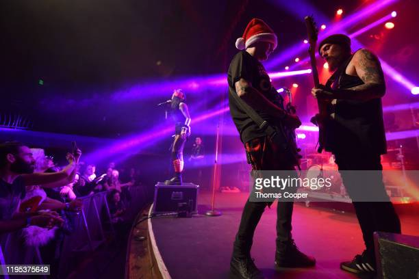 Lead singer Lola Black Chris Dillinger bass and Taylor Steele guitarist perform at the Gothic Theatre on December 21 2019 in Englewood Colorado
