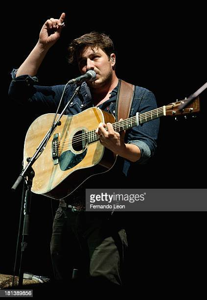 Lead singer Marcus Mumford performing with his band Mumford Sons at the Cricket Wireless Amphitheater on September 20 2013 in Kansas City Kansas