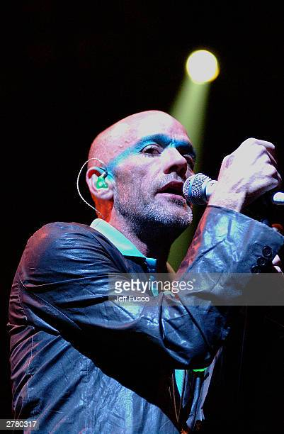 Lead Singer Michael Stipe of REM performs at the The Liacouras Center on October 1 2003 in Philadelphia PA in support of their latest CD The Best Of...