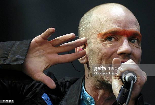 Lead singer Michael Stipe of REM performs during The T In The Park Festival on July 12 2003 at Balado near Kinross in Scotland
