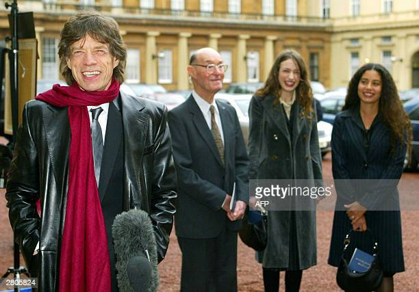 Lead singer of British group the Rolling Stone Sir Mick Jagger speaks to reporters as his his 92yearold father Joe and daughters Elizabeth and Karis...